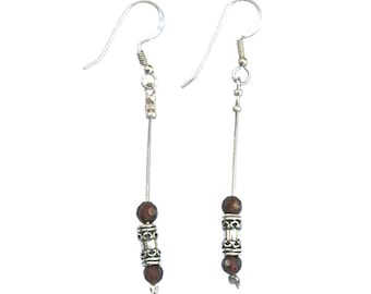 Sterling Silver earrings with ethnic sterling silver bead and garnets - er005