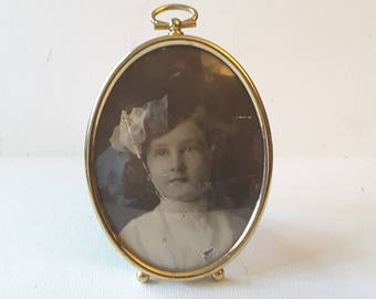 Reduced. Oval brass frame, with glass
