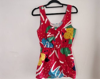 Strawberry fruit cup, chore pocket, button back tank. Size small.