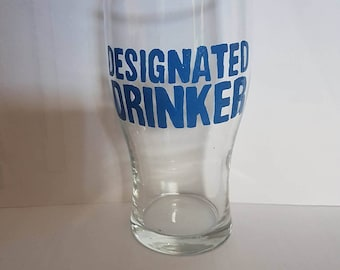 "Hand painted ""designated drinker"" pint glass."