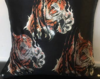 Tiger designs on black satin fabric