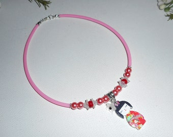 Necklace kokeshi child with flowers on buna cord pink and pink glass beads