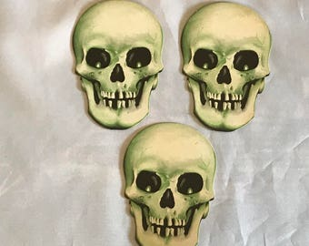 Lot of three vintage Halloween cardboard die cut skull skeleton
