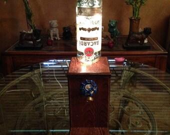 Lighted Bottle Faucet Lamp.  This is a LAMP. 44.95 Is No Bottle (NB) Option. Pillar Base. Not A Dispenser.