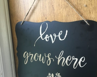 Love grows here wall decor hanging