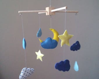 Baby mobile. Blue sky.