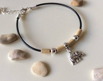 Handmade leather bracelet with beads and elephant charm. Extendable bracelet. Elephant charm bracelet. Elephant charm and bead jewellery.