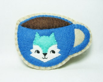 A tiny happy fox that loves coffee felt brooch