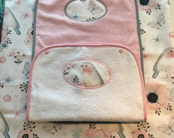 Cover, changing mat with two diapers.