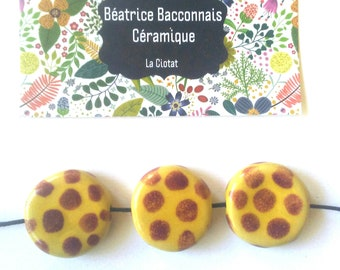 3 yellow beads with red polka dots ceramic