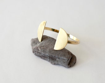 Modern statement cuff bracelet in brass, with two big half circles