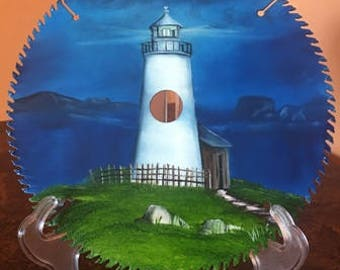 light house hand painted on 10 inch round metal saw blade