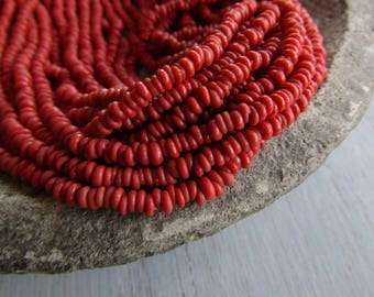Mini tiny  red rondelle lampwork glass beads, delicate, opaque  semi matte, Indonesian ethnic 1 to 1.5 x 3mm ( 22 inches strand ) 7bb13-6