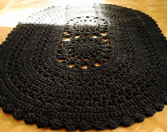Big black oval crocheted rug