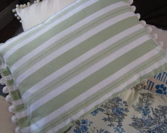 Green and white striped pillow covers with pompom trim in 2 sizes