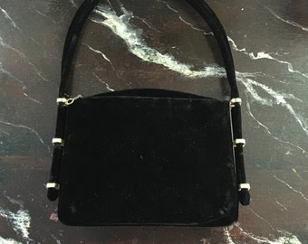 c handbag in black,circa1960,with silk satin on one side and velvet on the other. Mint