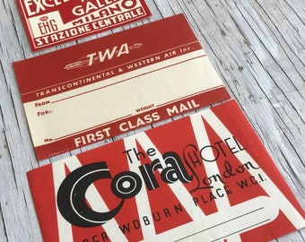 Three red typographic luggage labels, Excelsior Hotel Gallia Milano, The Cora Hotel London and TWA Transcontinental & Western Air Inc. 1950s