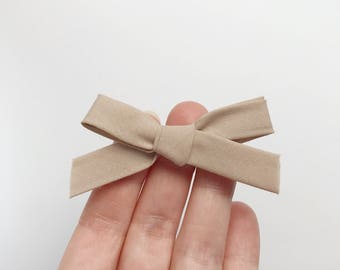 Bow tie on headband or hair clip - baby girl and boy - bias - beige