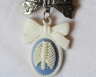 "Brooch ""Lucky Bow Ribcage"" white and blue"