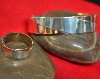 A set of Copper and Silver Cuff Bracelet and Ring