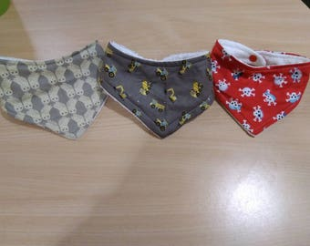 Cotton bibs in three designs, pirate skull and crossbones, vehicles and owls. 1