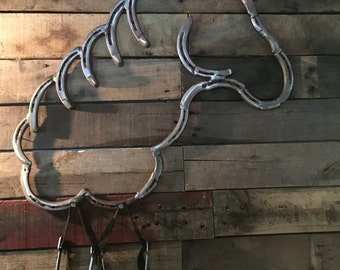 Horse head made from horse shoes
