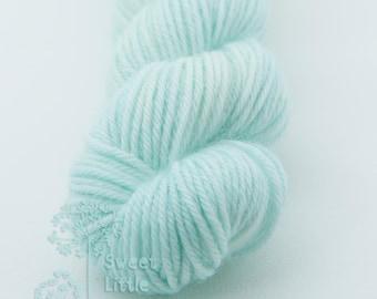 Mini skein - Beautiful hand dyed light blue hank of sock weight superwash merino wool