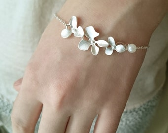 Silver plated orchid flowers bracelet with white pearl bead. Bridal gift. Gift for her