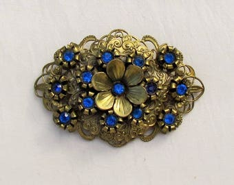 Vintage brass filigree pin with blue rhinestones, Victorian Revival brooch