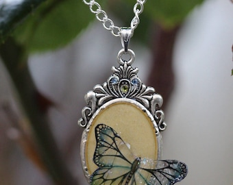 Yellow chartreuse and iridescent Butterfly pendant