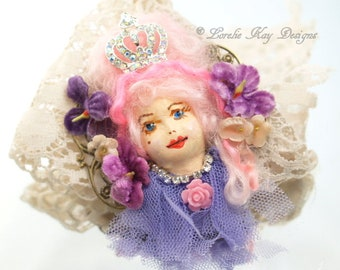 Pink Princess Brooch Hand Painted Doll Face Pink Hair Girl  Assemblage Wearable Doll Head Jewelry Lorelie Kay Original