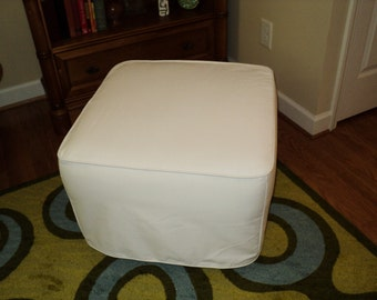 Custom made slipcover for your ottoman from your own fabric.  This one is Pottery Barn's dream nursery ottoman.