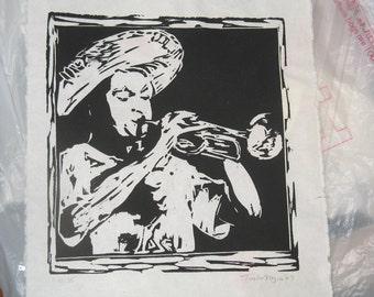 black and white linocut print trumpet player
