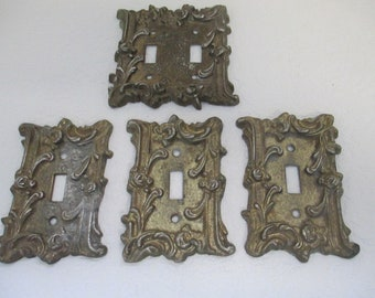 Vintage set of 4 repeat relief swirl design  brass light switch covers used
