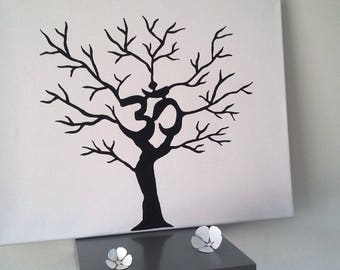 """Tree with """"OM"""" zen prints for about 70-80 people and 1 pad 4 colors available"""