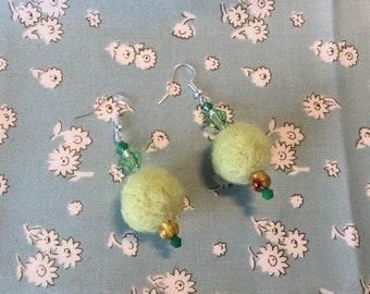 Green pom pom earrings