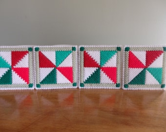 Four needlepoint coasters Christmas handmade.  Each one measures 4in by 4in.