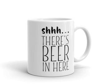 Coffee Cup. Shhh... There's beer in here