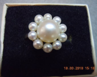 Mikimoto ring set in Sterling - Great Condition.  Center is 8mm with 3.5mm around.