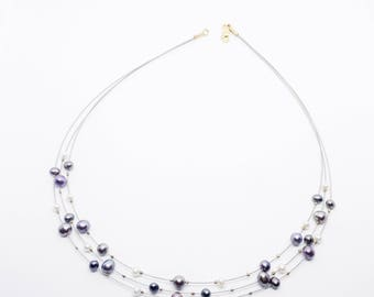 3-row pearl necklace with steel and gold