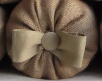 bolster pillow with safari tan cotton bow and button 1X6, 16X6