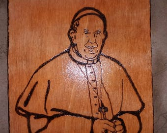 Burning painting by hand. Pope Francis