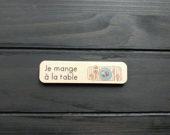 Task responsibility wooden symbol. I eat at the table.  The challenges of the Pack task Board. 5-10 years