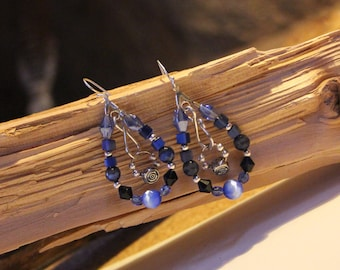 Beautiful shades of blue and silver colors dominate this hoop style set of earrings.
