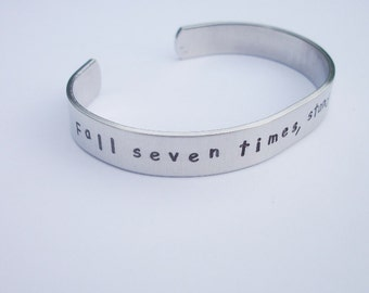 Fall Seven Times - Stand Up Eight - Hand Stamped 3/8 Inch Aluminum Cuff Bracelet