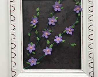 Frame with purple flowers