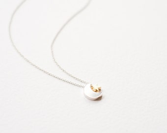 Delicate silver moon and gold star necklace