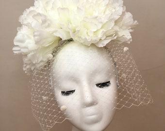 White statement floral headpiece.