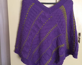 purple poncho with green patterned stripes in a wool/cotton blend