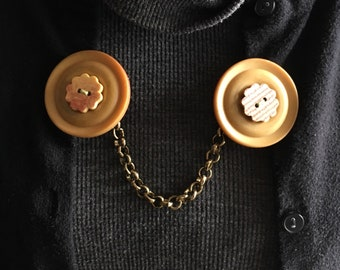 large button sweater clip